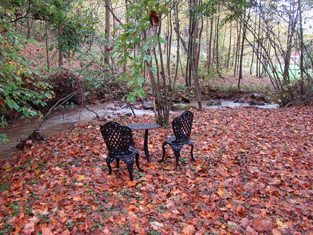 On the trail along the creek there is a bistro table