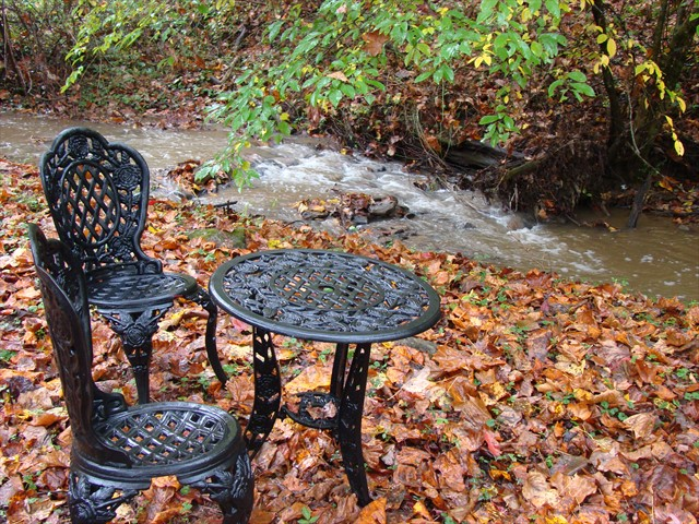 There is a bistro table along the creek