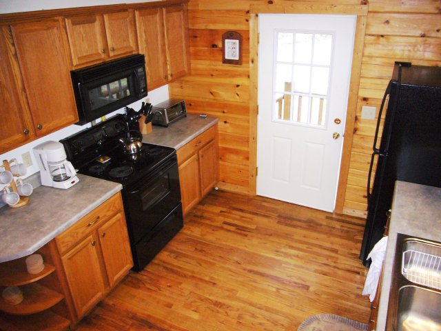 The cabin features a full size kitchen