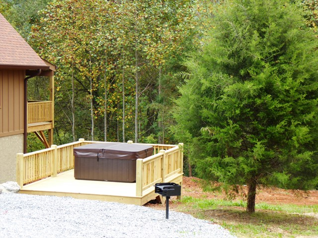 Outside the side yard includes the hot tub and barbecue gril