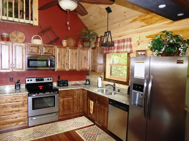The spacious Kitchen has granite counter tops and stainless